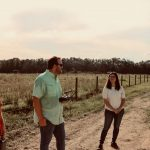 Hunter Smith, Dylan Stewart, Alina Zare and Chris Wilson standing near a cow pasture
